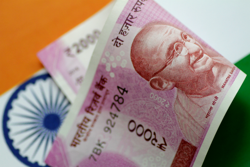 Rupee slips marginally in opening deals