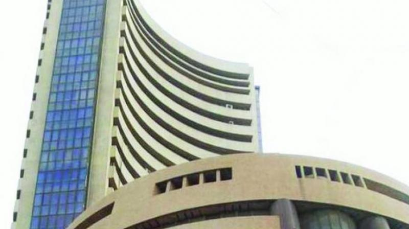 Sensex falls over 100 points after IMF cuts India
