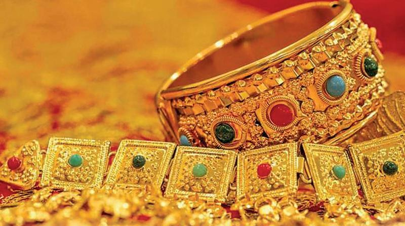 Gold slips Rs 40 to Rs 39,600 on muted demand