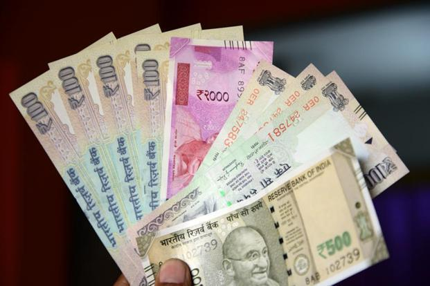 Rupee moves up 10 paise against dollar