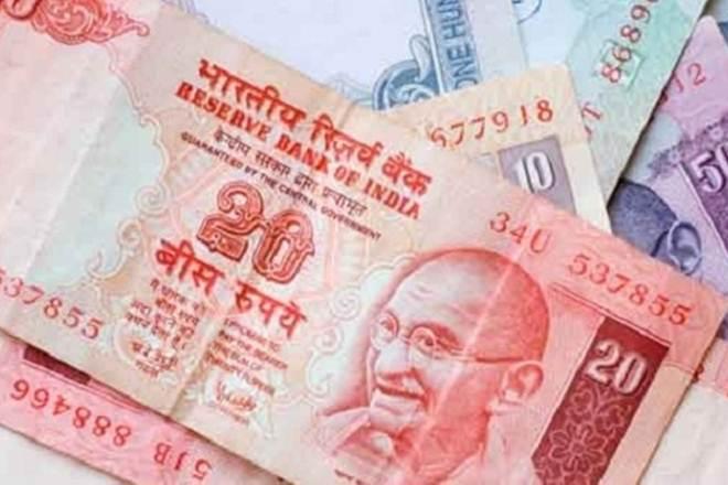 Rupee gains 20 paise against US dollar