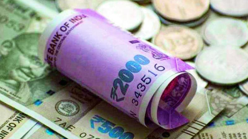 Rupee hits new low of 74.27, plunges 21 paise against dollar