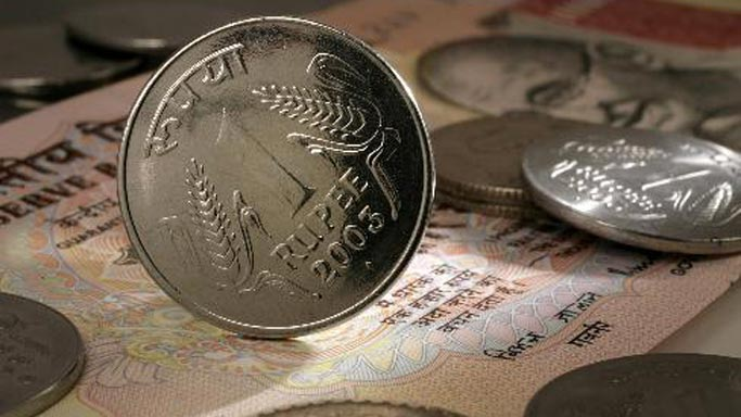 Rupee falls 14 paise against US dollar