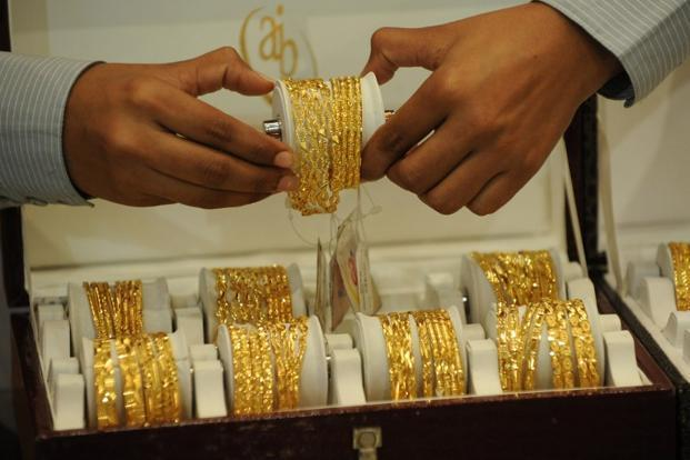 Gold prices rise Rs 145; silver falls Rs 350