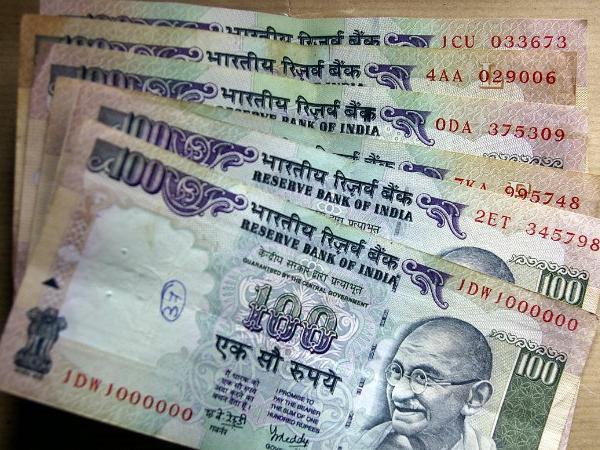 Rupee rises 21 paise against US dollar