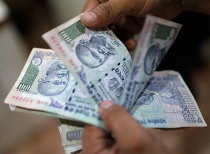 Rupee climbs 4 paise against dollar