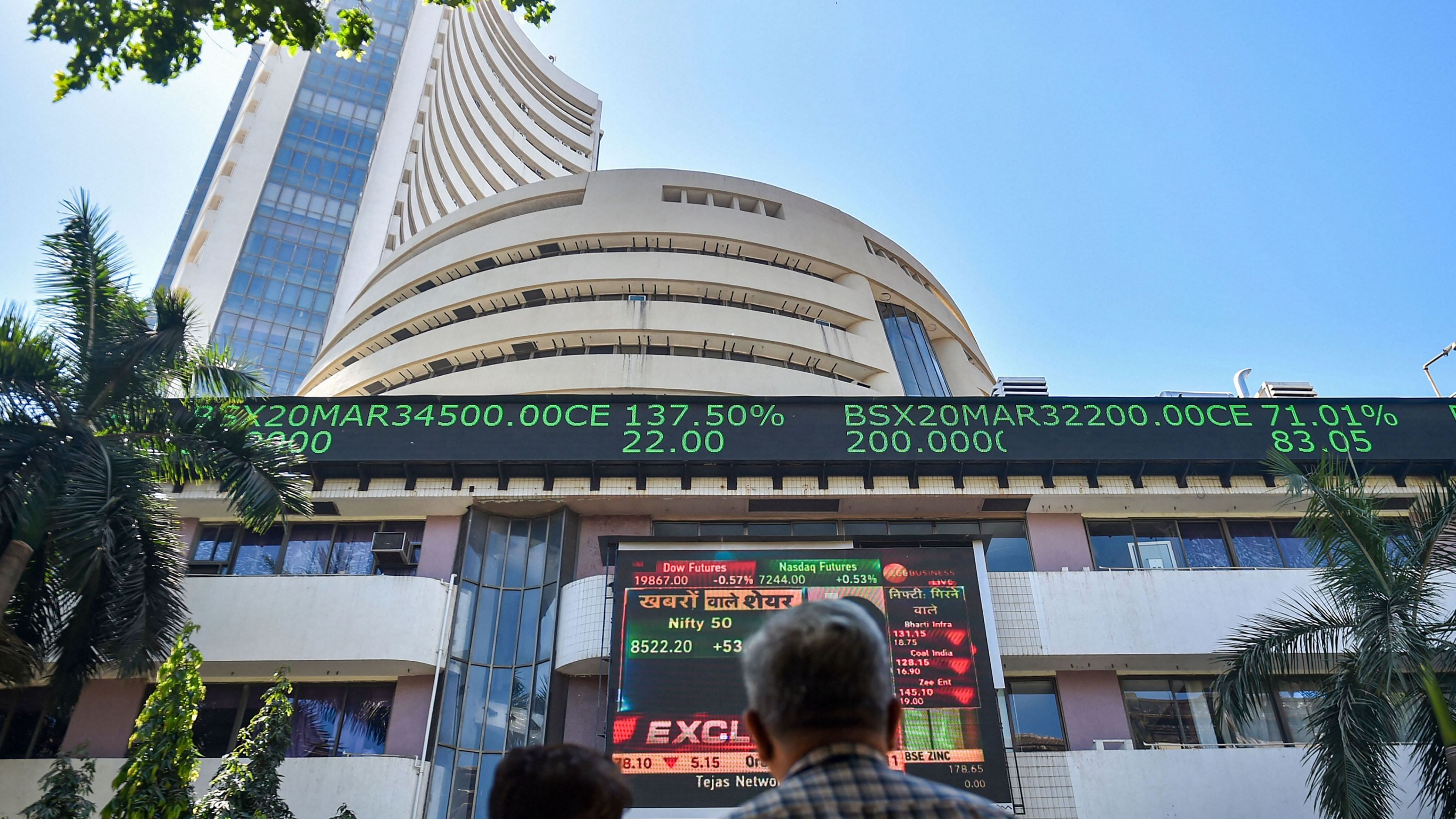 Sensex rallies over 500 points to hit new peak