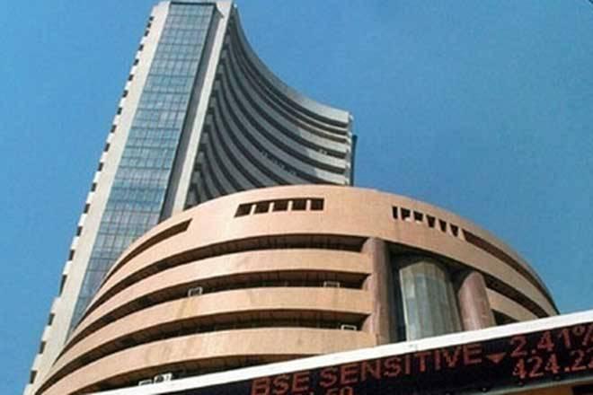 Sensex slips 137 points in volatile trade