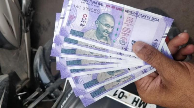 Rupee slips 16 paise against US dollar