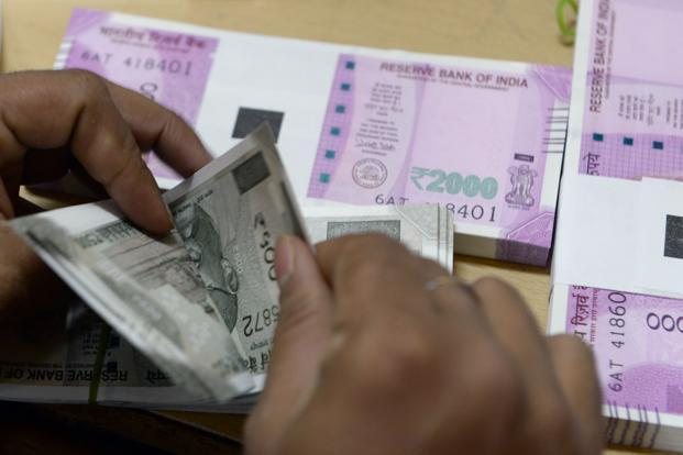 Rupee softens 10 paise against US dollar