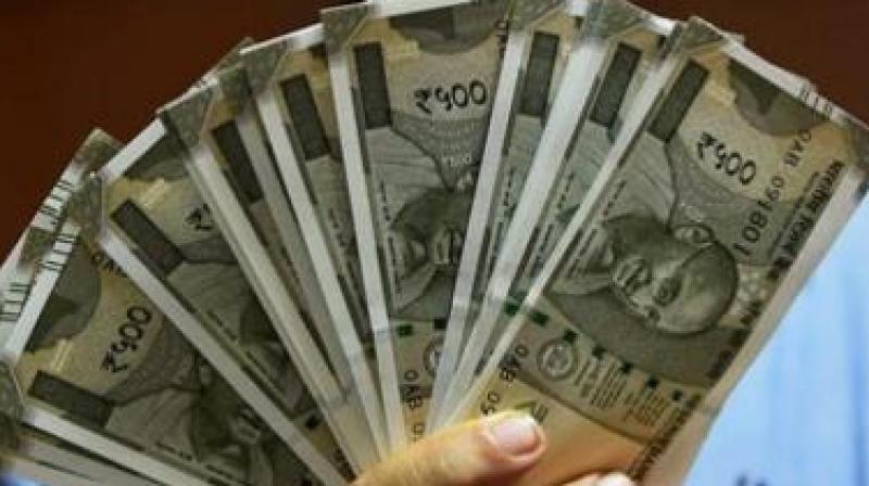 Rupee climbs 15 paise against dollar