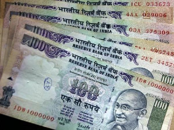 Rupee rises 4 paise against US dollar