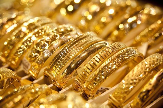 Gold falls on weak global cues, muted demand