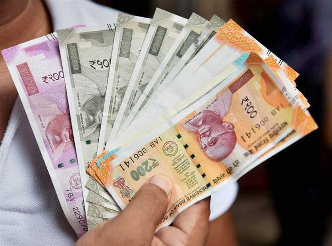 Rupee rises 12 paise against US dollar