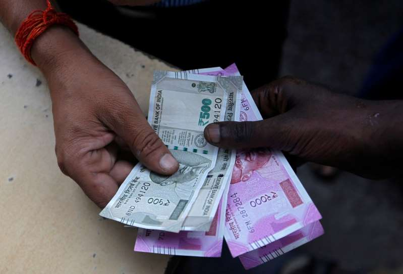 Rupee breaches 72 a dollar mark for first time