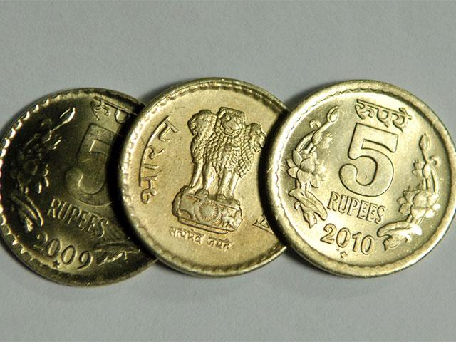 Rupee slips 4 paise against dollar