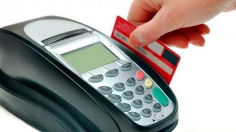 RBI rationalises charges on debit card transactions