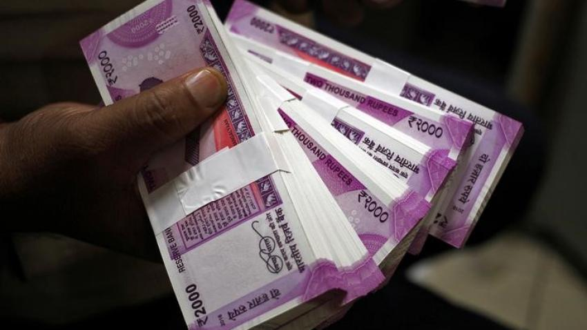 Rupee jumps 5 paise against dollar