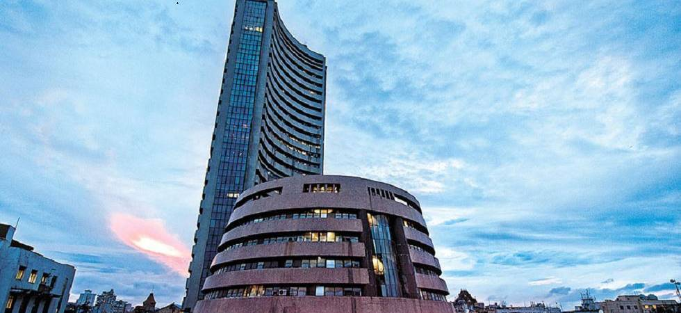 Sensex, Nifty turn volatile on weak global cues