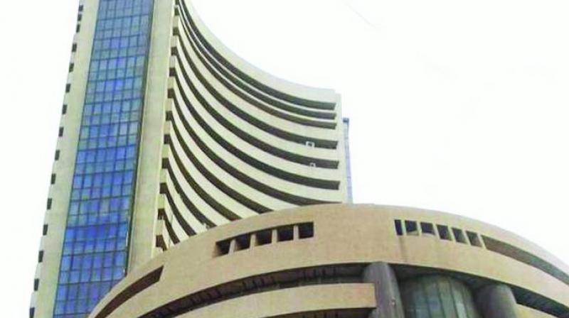 Sensex slips 82 points on weak global cues