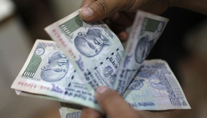Rupee down 13 paise against dollar