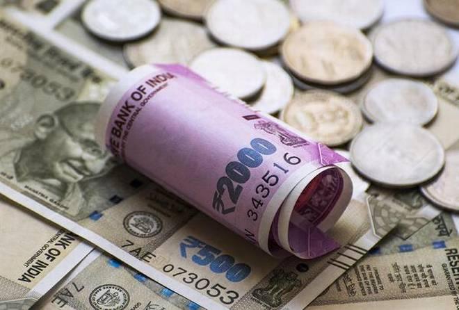 Rupee gains 12 paise against dollar