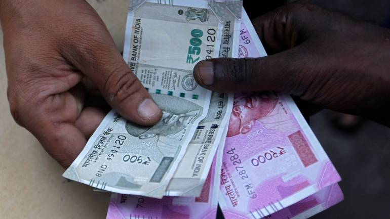 Rupee rises 26 paise to 70.88 against US dollar