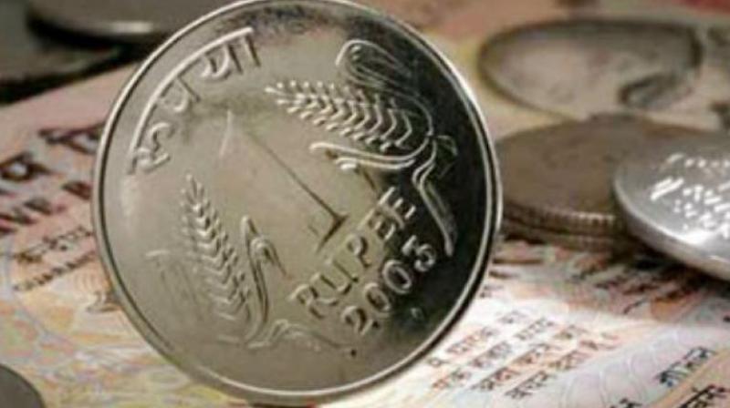 Rupee gets macro data lift, up 23 paise at 64.08