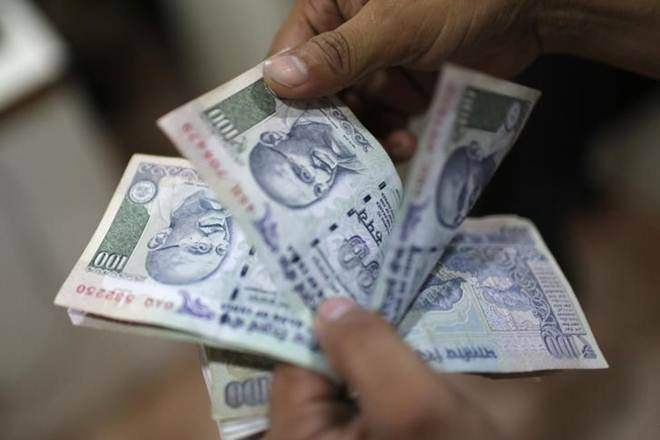 Rupee slips 20 paise against US dollar