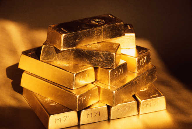 Gold futures fall 0.29 pc on weak global cues