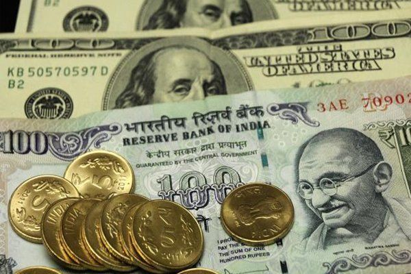 Rupee gains 11 paise against dollar