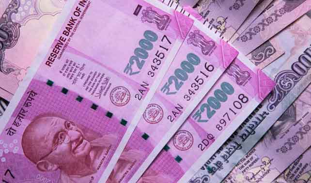 Rupee goes up 7 paise against US dollar
