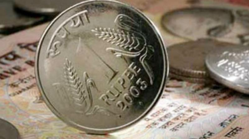 Rupee slips 4 paise against US dollar in early trade
