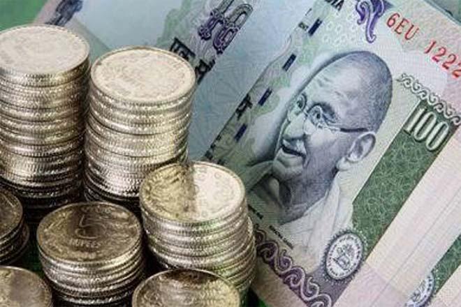 Rupee falls 14 paise against dollar