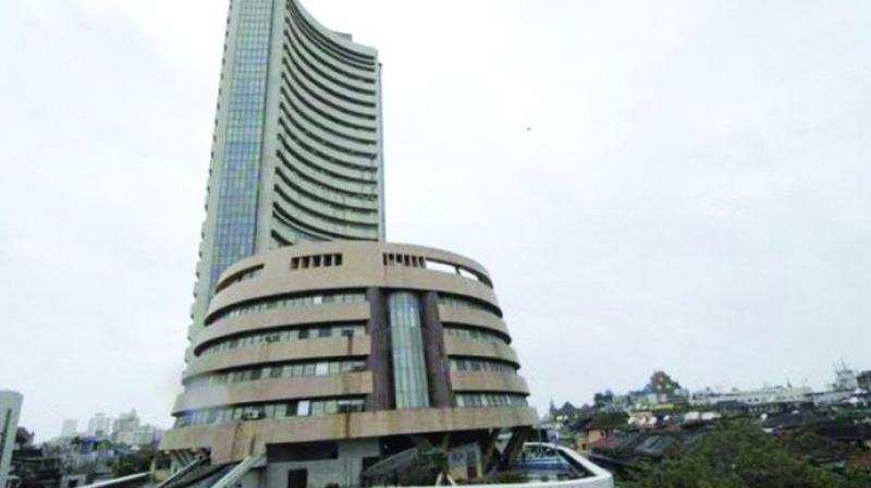 Sensex drops over 100 points on weak global cues