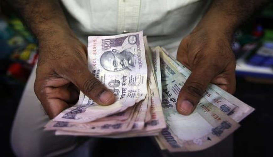 Rupee holds 1—mth high of 64.33 as dollar crumbles