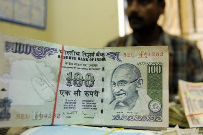 Rupee slides 15 paise against dollar