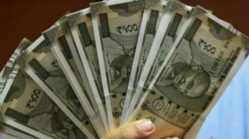 Rupee recovers 6 paise against US dollar