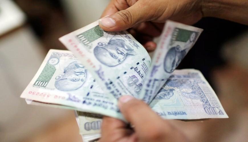 Rupee gains 2 paise against dollar, Fed decision ahead