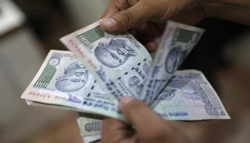 Rupee slips 15 paise against US dollar