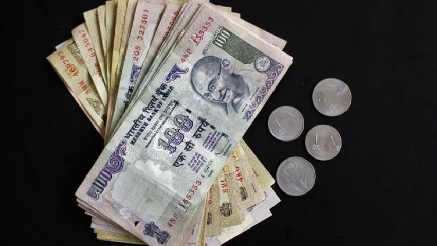 Rupee spurts 10 paise against dollar