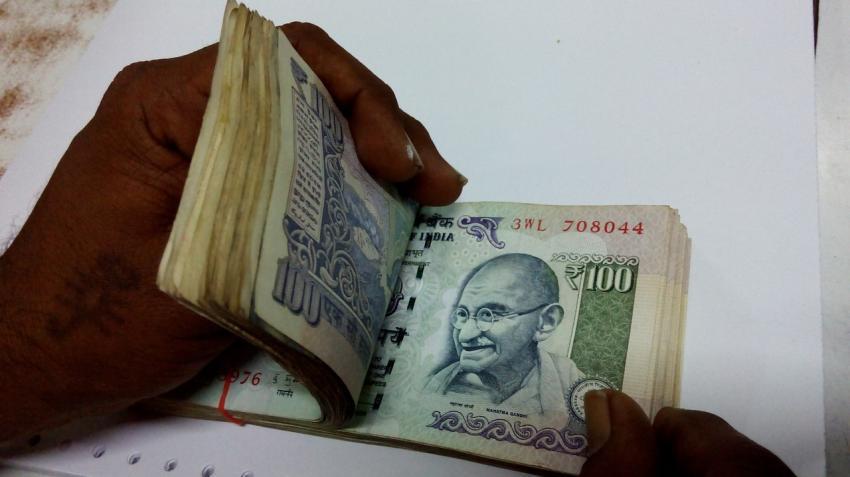 Rupee climbs up 14 paise on dollar