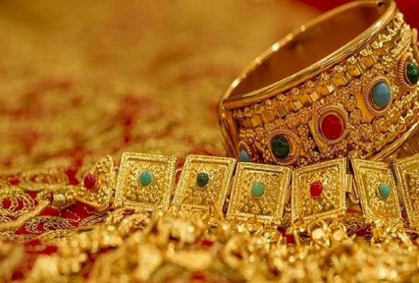 Gold prices down by Rs.26 to Rs.49,245 per 10 gram in Delhi