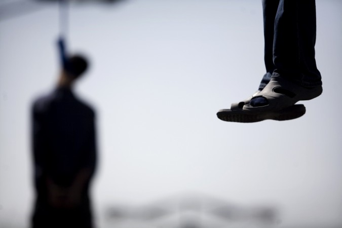 Man hangs self after wife