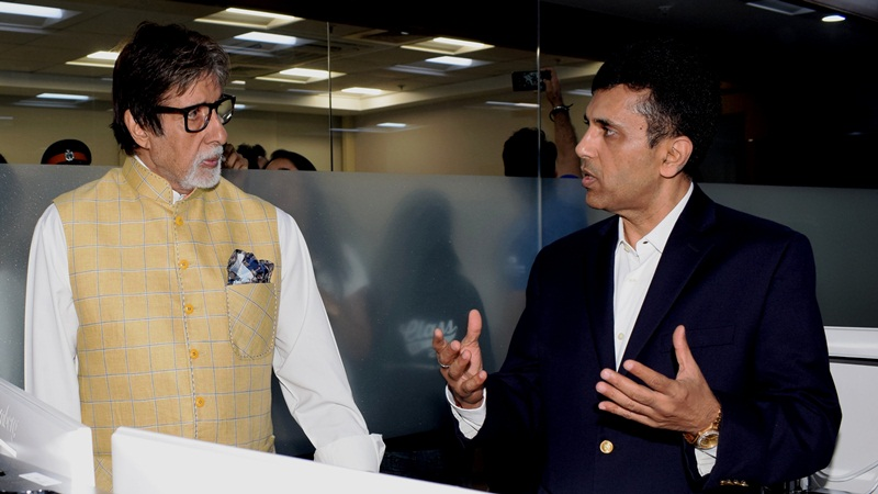 Actor Amitabh Bachchan distributes hearing aids at charity function