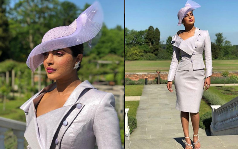 Priyanka Chopra arrived for the royal wedding in a lavender Vivienne Westwood skirt and blaze