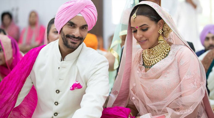Neha Dhupia and Angad Bedi announced their wedding on Twitter with adorable picture.
