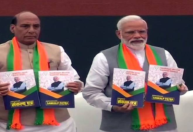 BJP releases manifesto, promises to build Ram temple; PM says nationalism