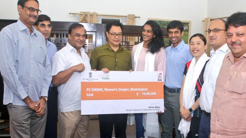 Sports Minister Kiren Rijiju presents Rs 10 lakh cheque to world champion Sindhu