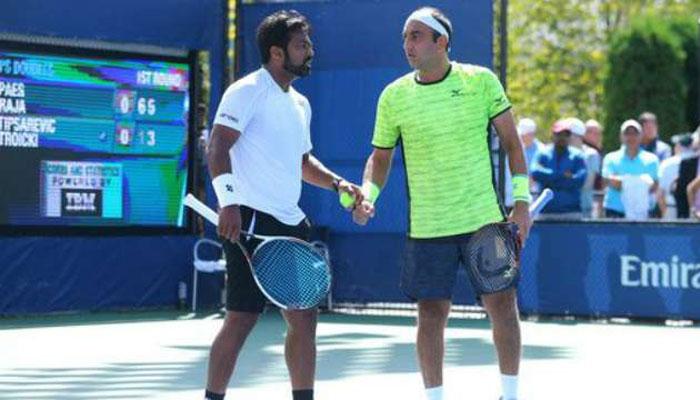 Leander Paes and Purav Raja lift men